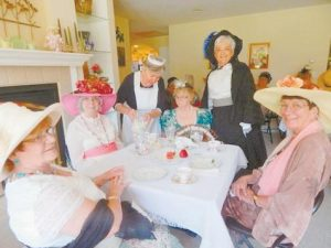 A VICTORIAN AFTERNOON TEA recently took place to benefit the Bowdoinham Food Pantry. From left are guests Priscilla Brown and Grace Anderson, tea-ser ving maid Joanne Savoie, a maid serving tea and one of the directors of the event; guest Shirley Harmon, Laurie Look, the other event director and the Victorian lady featured in the entertainment, and guest Judy Gray.