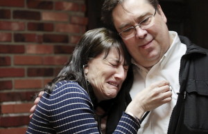 Sue Ellen Monaghan listens with a stethoscope to the heart of her son, Tim Conley, beating in Jon Claflin's chest.