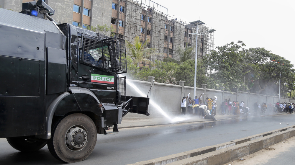 A police water-cannon disperses women demonstrators as they try to march to the town center, in the Ngagara district of Bujumbura, Burundi Wednesday.