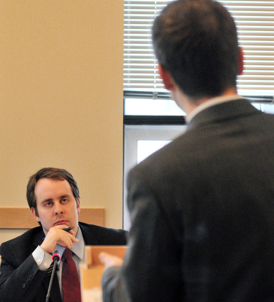 Sen. Eric Brakey, R-Auburn, co-chair of the Health and Human Services Committee, listens as Rep. Scott Hamann, D-South Portland, speaks about child care for foster children.