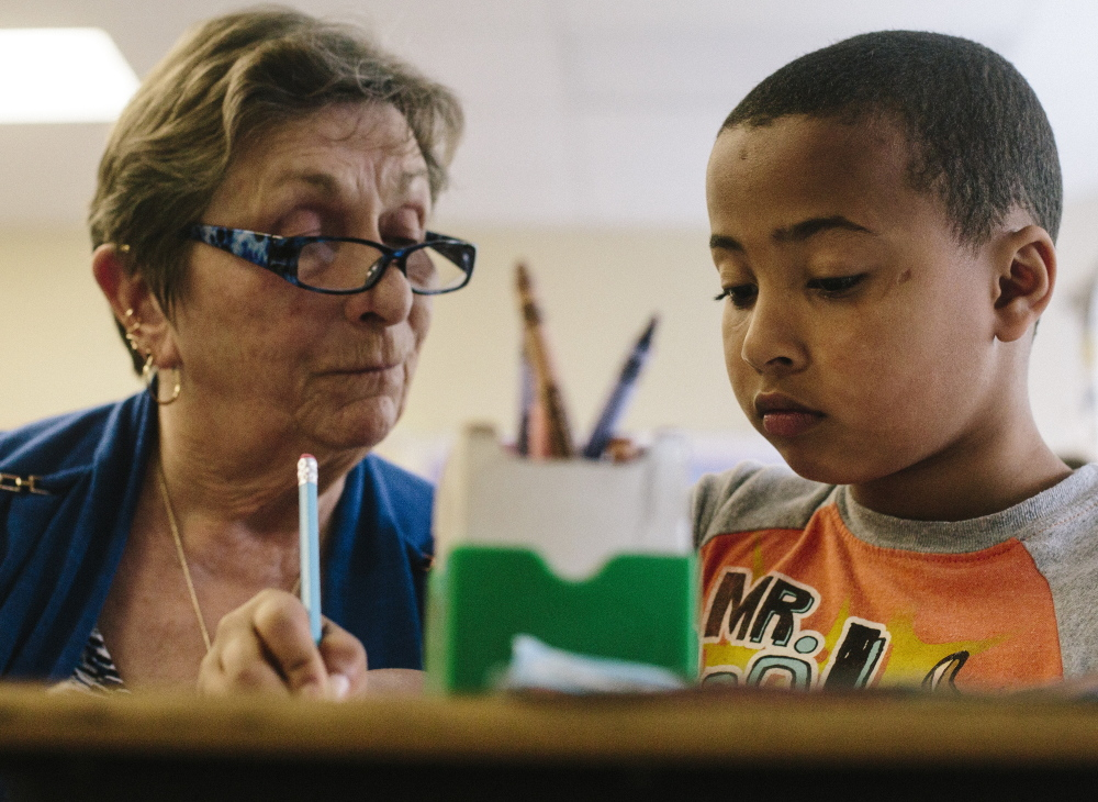 Seeley gives Donald Enman, 9, some one-on-one attention in Barbara Judge's third-grade class at Lyseth. She is one of five volunteers out of a national pool of 360,000 to be honored as a Senior Corps Hero.