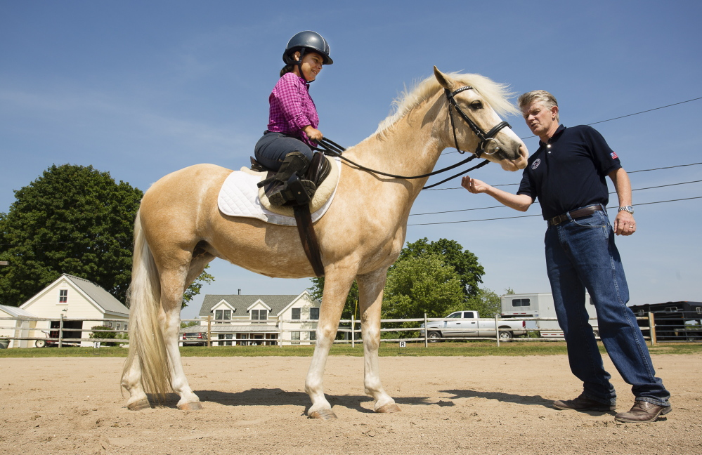 Para-equestrian athlete Meghan Benge of Aiken, S.C., is coached by Kai Handt, the U.S. Paralympic equestrian team coach in Lyman on Saturday.  Carl D. Walsh/Staff Photographer