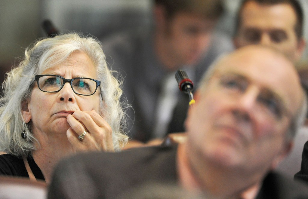 Rep. Joyce McCreight watches the tally board during Monday's House vote on the bill to make concealed-weapons permits optional.