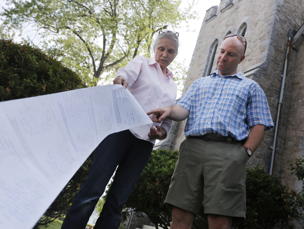 Bobbi Cope, left, and John Thibodeau say they have collected over 450 signatures opposing the proposed zoning change in Deering Center that would allow the site of St. Joseph's Convent to be converted into 88 units of senior housing and the fields behind the convent to be used for four or five new buildings. Derek Davis/Staff Photographer