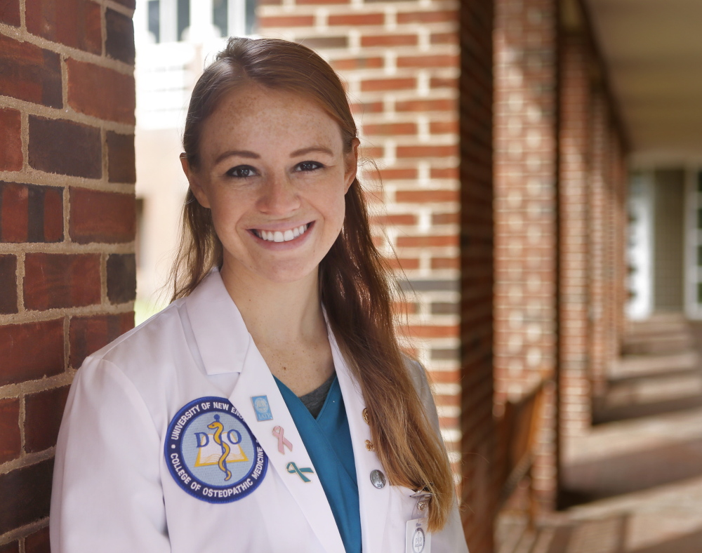 A second-year student at the University of New England College of Osteopathic Medicine in Biddeford, Kristina Michaud believes her degree will afford her the opportunities to pay back her sizable debt.