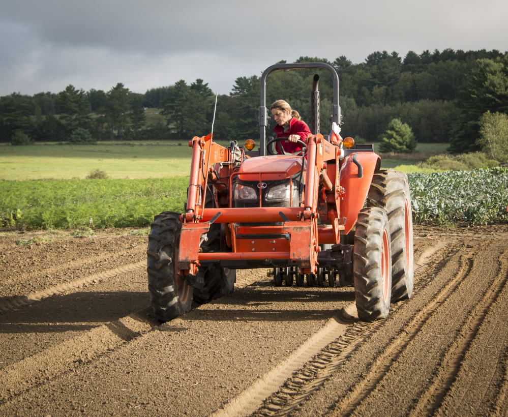 """Seeding at Goranson Farm in Dresden, one of the six Maine farms featured in Peter Felsenthal's book of interrviews and photos, """"New Growth."""""""