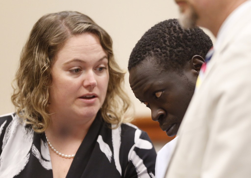 Gang Deng Majok confers with his attorney Kristine Hanley while being arraigned in the Cumberland County Courthouse in Portland on Wednesday in connection with the killing of Treyjon Arsenault.