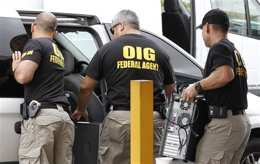 """Federal agents with the Office of Inspector General load computers seized from Willsand Home Health Agency Inc. into a van in Miami. Since 2007, nine regional """"strike forces"""" of the Justice, Treasury and Health and Human Services departments have charged about 2,300 people who had falsely billed Medicare for $7 billion. The Associated Press"""