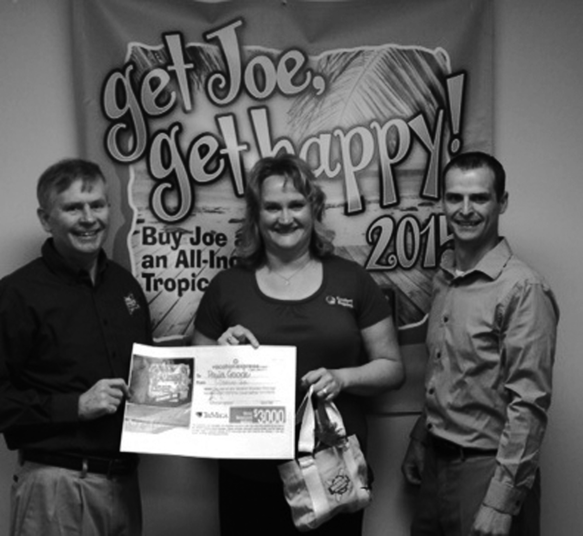 Warren Roberts owner of Warren's Office Supplies in Sanford and Skowhegan is shown here with Paula Goode and Tyler Hartt, a representative of Genuine Joe breakroom and paper products. Goode was the winner of a tropical vacation recently sponsored by the two entities.