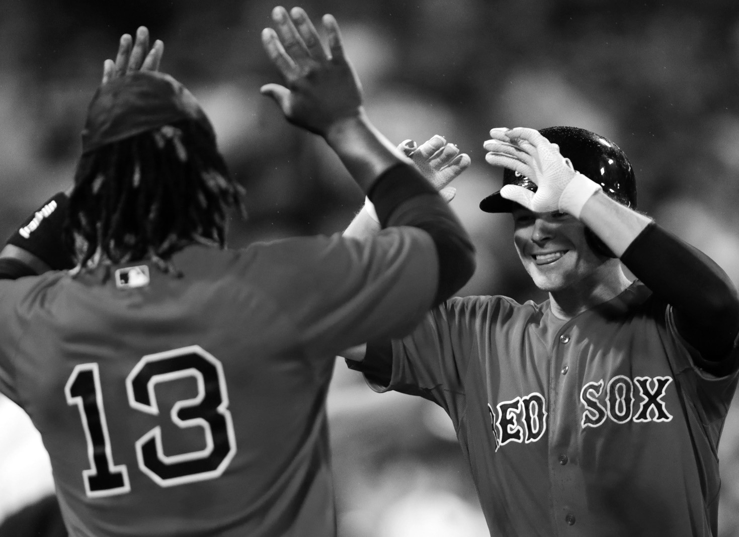 Boston Red Sox's Josh Rutledge, right, is congratulated by Hanley Ramirez after his two-run home run against the Kansas City Royals during the sixth inning at Fenway Park on Friday.