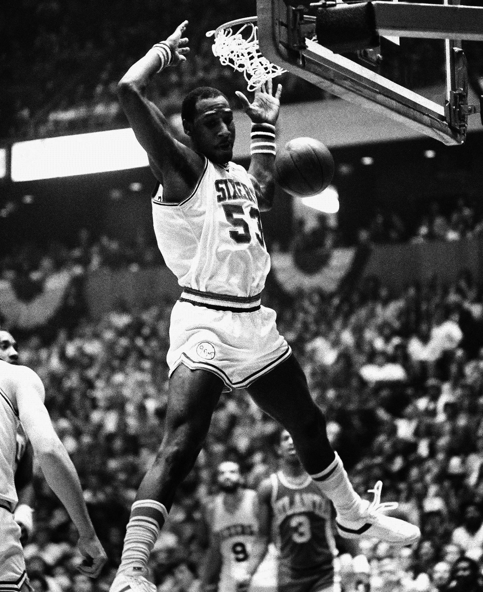 "In this April 15, 1980, file photo, Philadelphia 76ers' Darryl Dawkins dunks against the Atlanta Hawks in an NBA playoff game in Philadelphia. Darryl Dawkins, whose backboard-shattering dunks earned him the moniker ""Chocolate Thunder"" and helped pave the way for breakaway rims, has died. He was 58. The Lehigh County, Pennsylvania coroner's office said Dawkins died Thursday morning at a hospital."