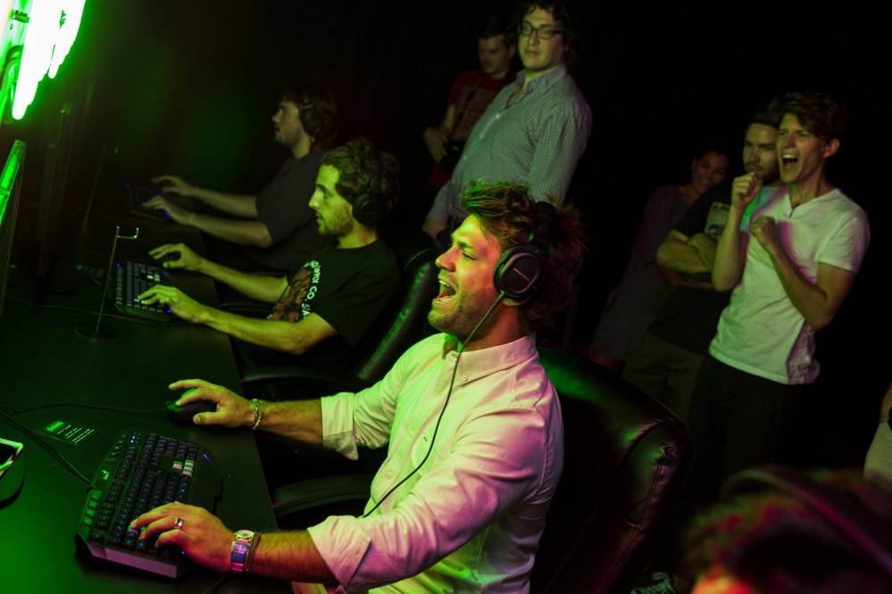 "Zefr co-founder and co-CEO Zach James, center, gets into the action during an internal tournament playing the video game ""Unreal Tournament"" in Venice, Calif.  Jay L. Clendenin/Los Angeles Times"