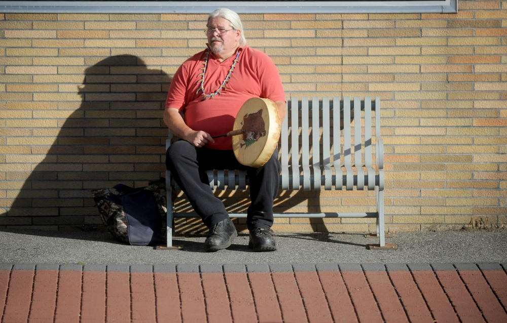 Mike Walton of Clinton plays his drum Thursday during a Native American rally at the Moonlight Madness festival on Water Street in Skowhegan.
