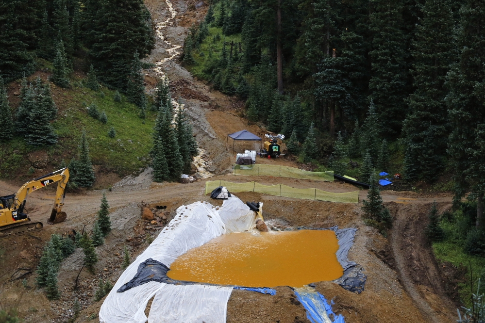 Water flows through one in a series of retention ponds built to contain and filter out heavy metals and chemicals from the Gold King mine wastewater accident, in the spillway about a quarter mile downstream from the mine, outside Silverton, Colo., Wednesday.