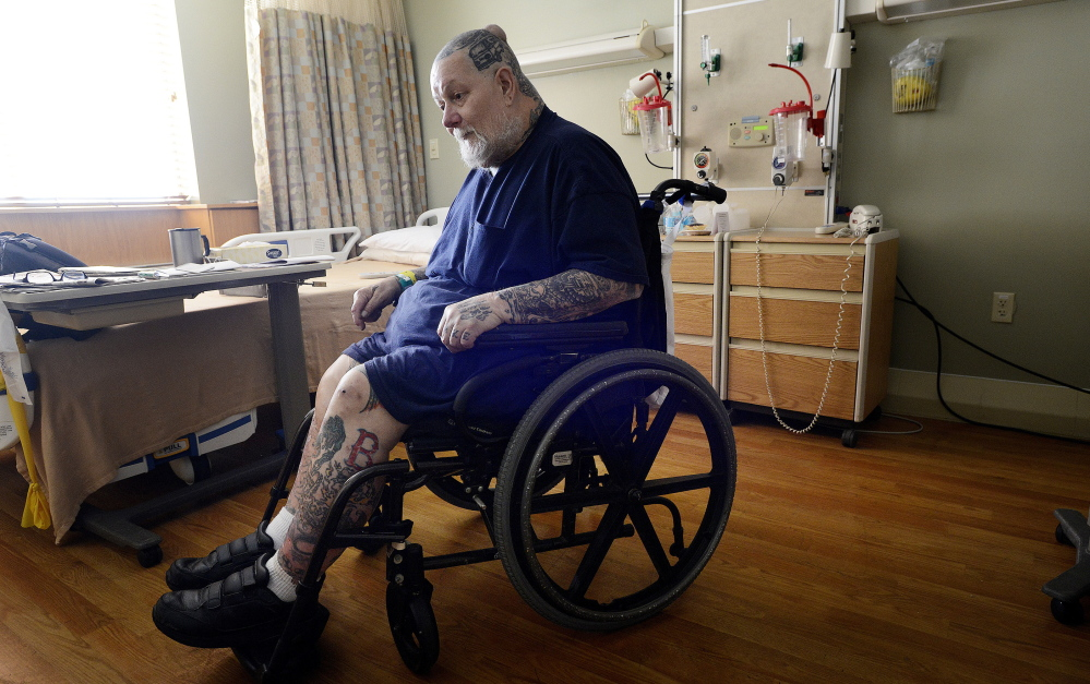 Eric Chipman, seen in a wheelchair in a hospital room at Southern Maine Health Care in Sanford on Wednesday, suffered a number of debilitating injuries as the result of a motorcycle accident in 1976.  Shawn Patrick Ouellette/Staff Photographer