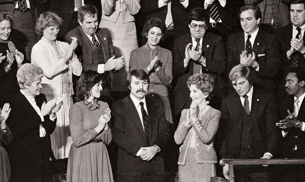 In this 1982 photo, Lennie Skutnik, center front,  the man who jumped into the Potomac River and saved one of the passengers aboard the Air Florida jetliner that crashed, receives applause from first lady Nancy Reagan and other dignitaries in Washington. The Associated Press