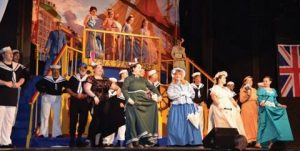 """THE FULL CAST of """"HMS Pinafore"""" sings"""