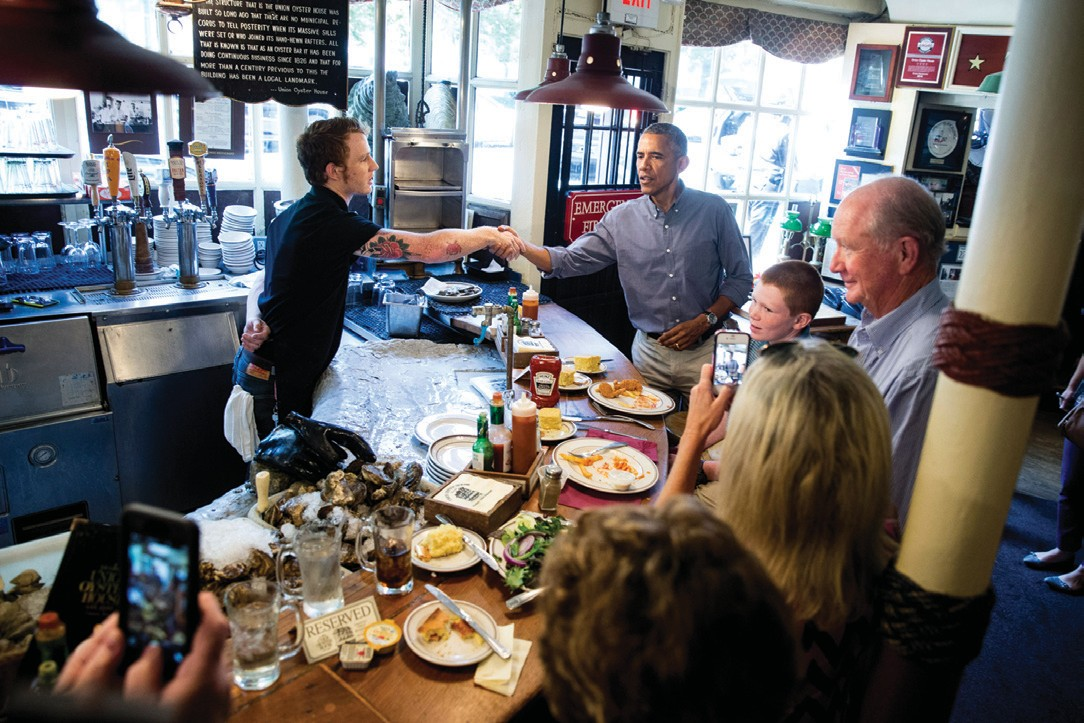 President Barack Obama greets people at Ye Olde Union Oyster House Monday in Boson.
