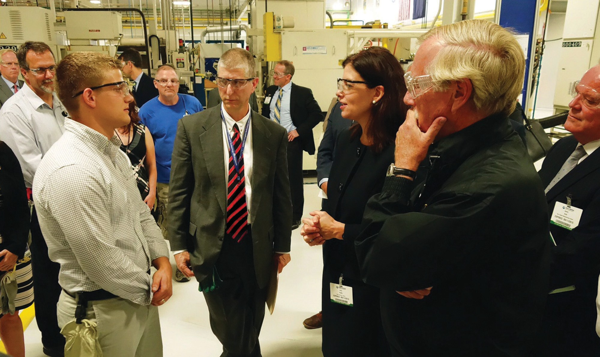 Sen. Kelly Ayotte, R-N.H., and Sen. Angus King, I-Maine, pose with Eric Matheson and Nick Claesson during a tour at Pratt & Whitney North Berwick Friday. Matheson is currently enrolled in the company's apprenticeship program, offered through a partnership with York County Community College. Claesson is one of several Thornton Academy High School students working at Pratt & Whitney as part of the National Tooling and Machining Association-U curriculum offered at the high school.