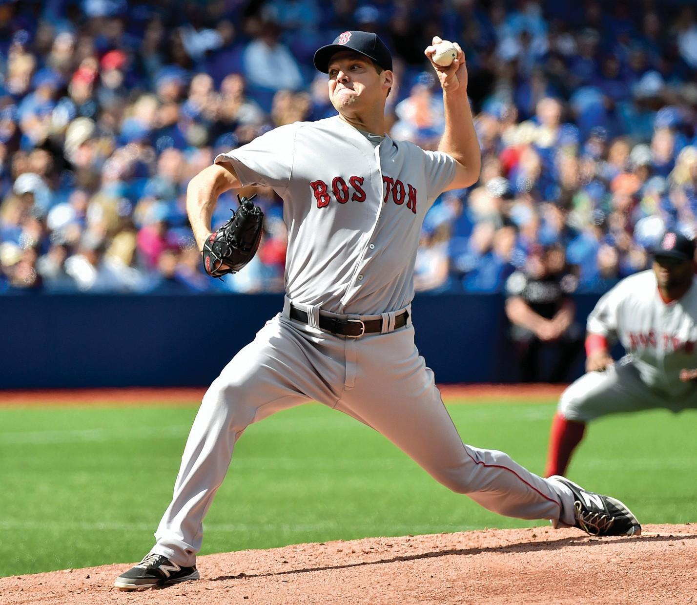 Boston Red Sox starting pitcher Rich Hill works against the Toronto Blue Jays during the first inning of a baseball game in Toronto on Sunday.
