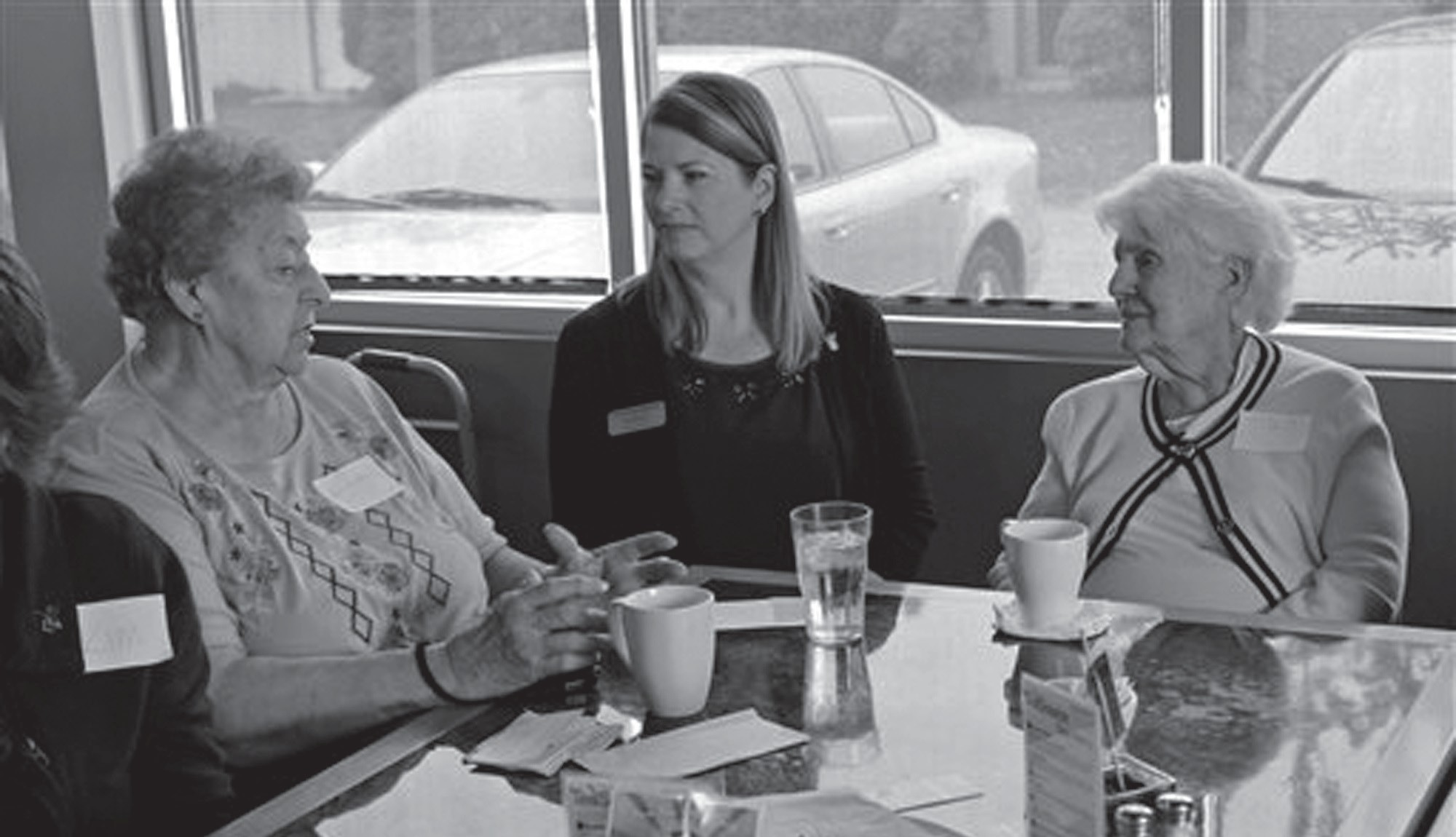 In this photo taken May 20 at Connections Cafe in Watertown, Wis., Shirley Strysick, right, 90, who suffers from dementia, talks with Stephanie Masche, center, from the Heritage Homes assisted living facility, and an unidentified woman during a social and support group for those with the disease and their caregivers.