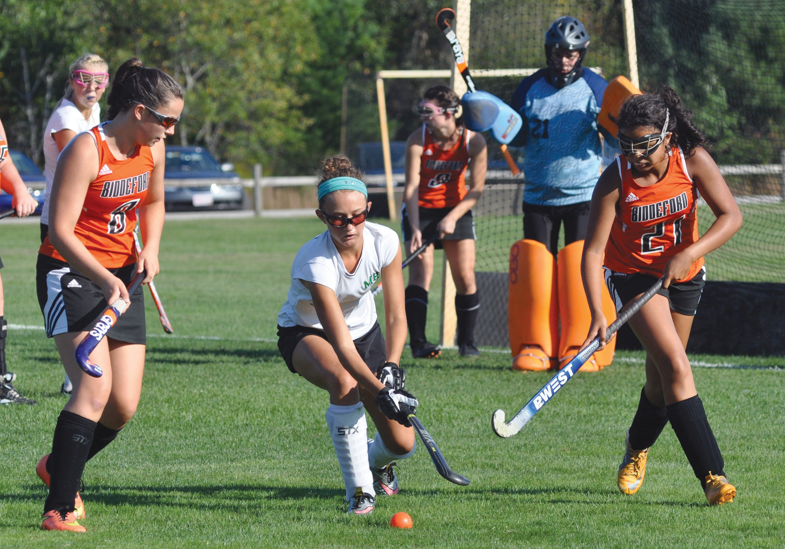 Massabesic's Logan Champlin, center, controls the ball between Biddeford's Peyton McKeown, left, and Jada Kimball during the Mustangs' 7-0 victory in Waterboro Wednesday. Champlin scored a pair of goals in the win.