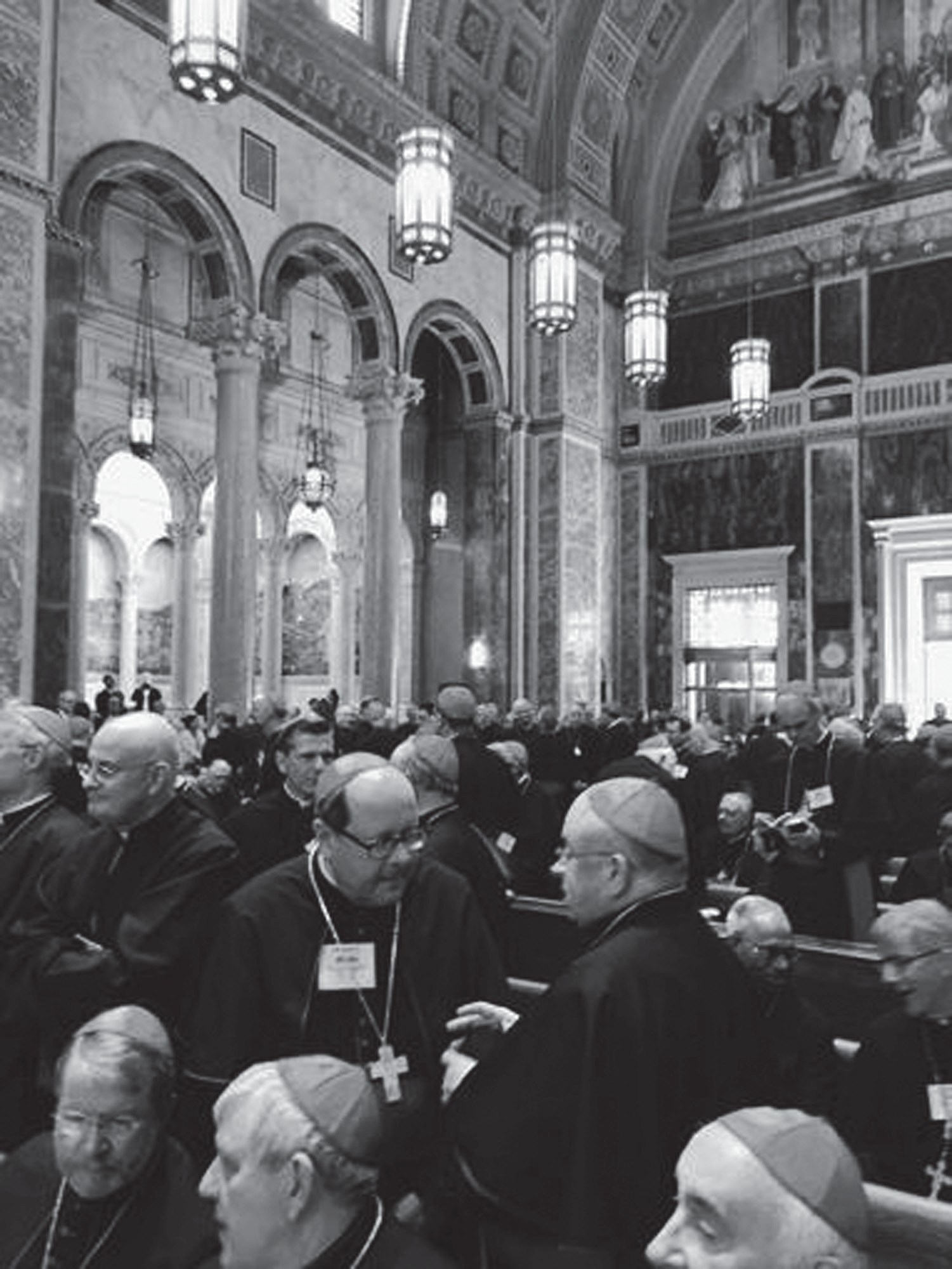 Bishop Robert P. Deeley of the Roman Catholic Diocese of Portland and the other U.S. bishops joined Pope Francis for midday prayer at St. Matthew's Cathedral in Washington, D.C. on Wednesday morning. Here, Deeley is pictured at the cathedral speaking with the other bishops.