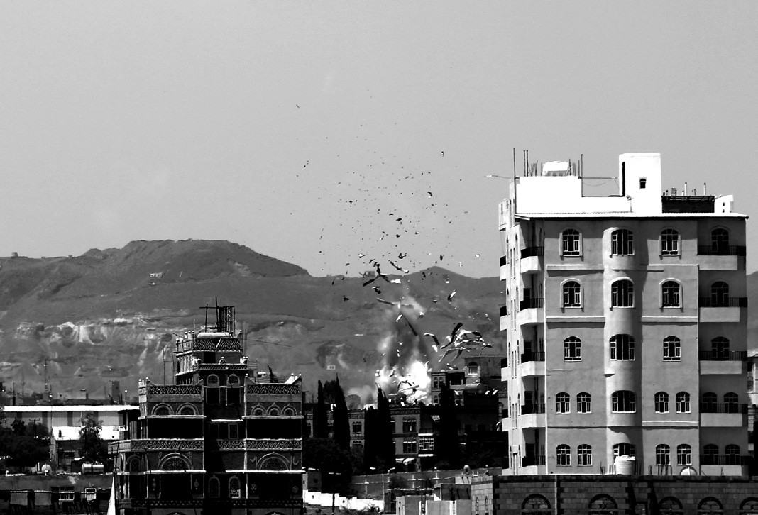 Debris and smoke rise after a Saudi-led airstrike hits an army base in Sanaa Monday.