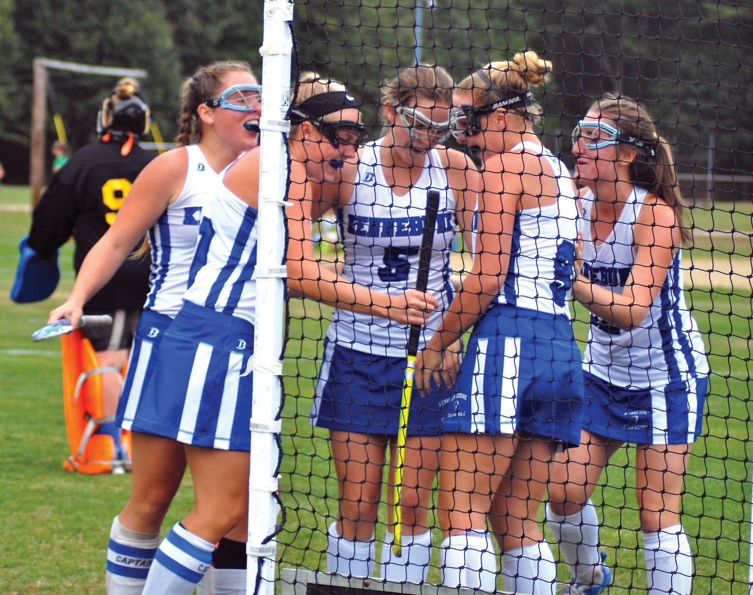 Members of the Kennebunk field hockey team celebrate after Liv Sandford scored the game-winner against Lake Region in overtime on Tuesday afternoon.