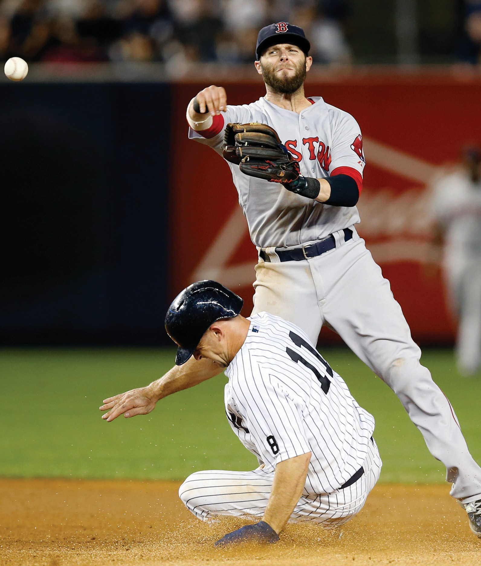 Boston Red Sox second baseman Dustin Pedroia (15) throws to first to complete a double-play after putting out New York Yankees' Brett Gardner during a baseball game in New York, Tuesday.