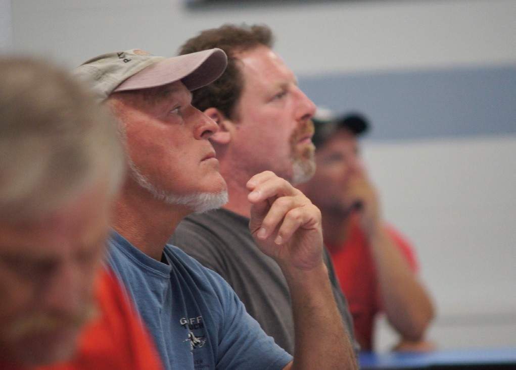 Members of the lobster industry listen intently to Department of Marine Resources Commissioner Patrick Keliher as he proposes changes to the entry program.