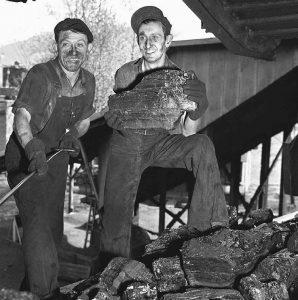 IN THIS MAY 4, 1943, PHOTO, workers at the Clover Fork mine at Harlan, Ky., return to work grading coal following a government-mine workers truce after several days of a work stoppage.