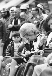 IN THIS MARCH 15, 1976, FILE PHOTO, relatives of miners killed in the second Scotia mine blast gather for a memorial service in Cumberland, Ky. Workers from mines in the area stopped work for the day to take part in the services and the bodies were never recovered.