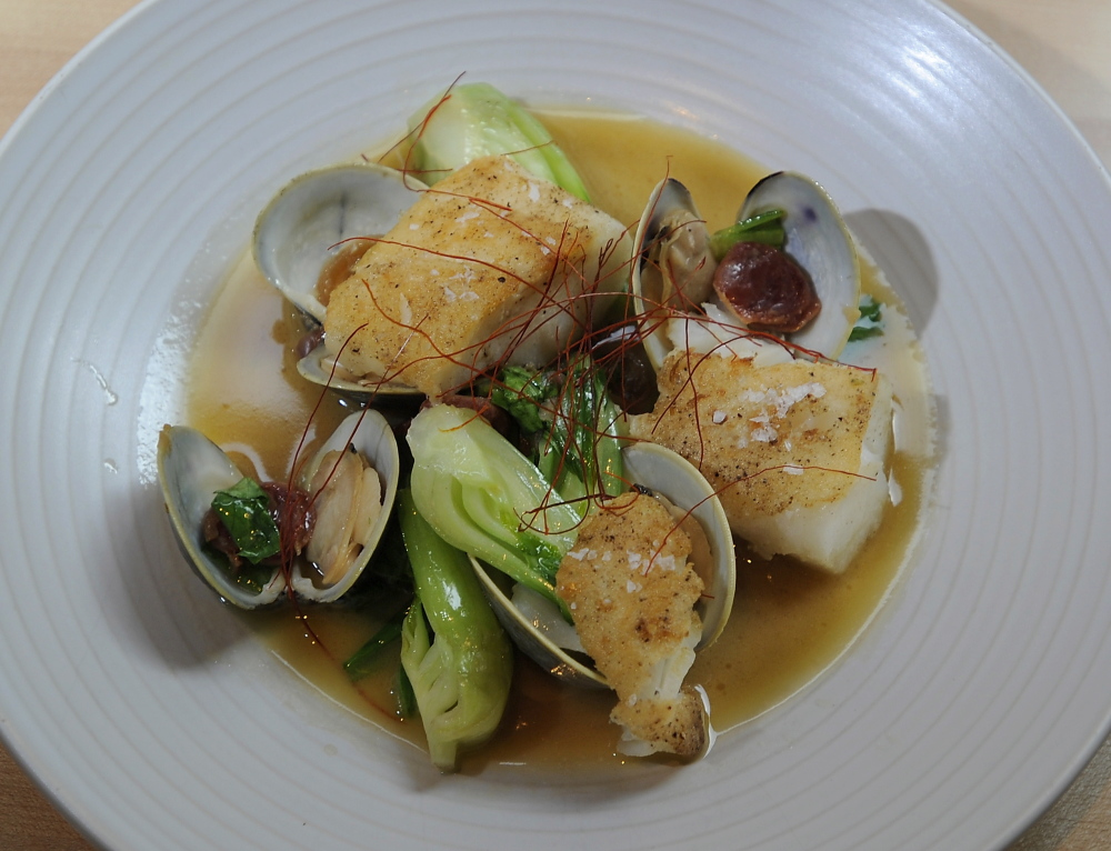 The Roasted Casco Bay Cod dish includes littleneck clams, soy brown butter, bok choy and Chinese fermented sausage.