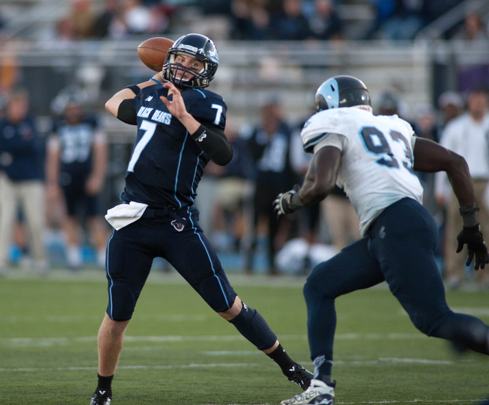 Maine quarterback Dan Collins gets pressure from Rhode Island defender Jose Duncan. Collins completed 14 of 25 passes for 211 yards, with no touchdowns or interceptions.