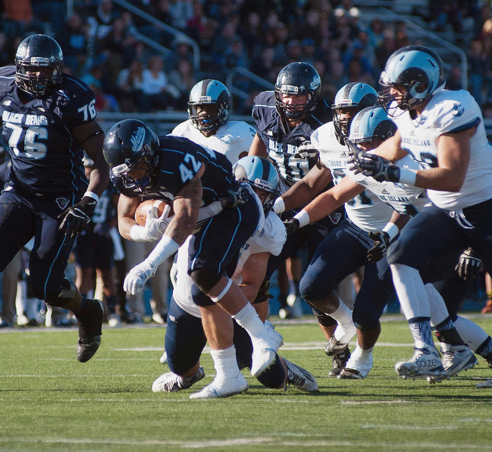 Maine running back Darian Davis-Ray battles for a few more yards against Rhode Island on Saturday. He rushed for 74 yards on 12 carries before leaving with an injury.
