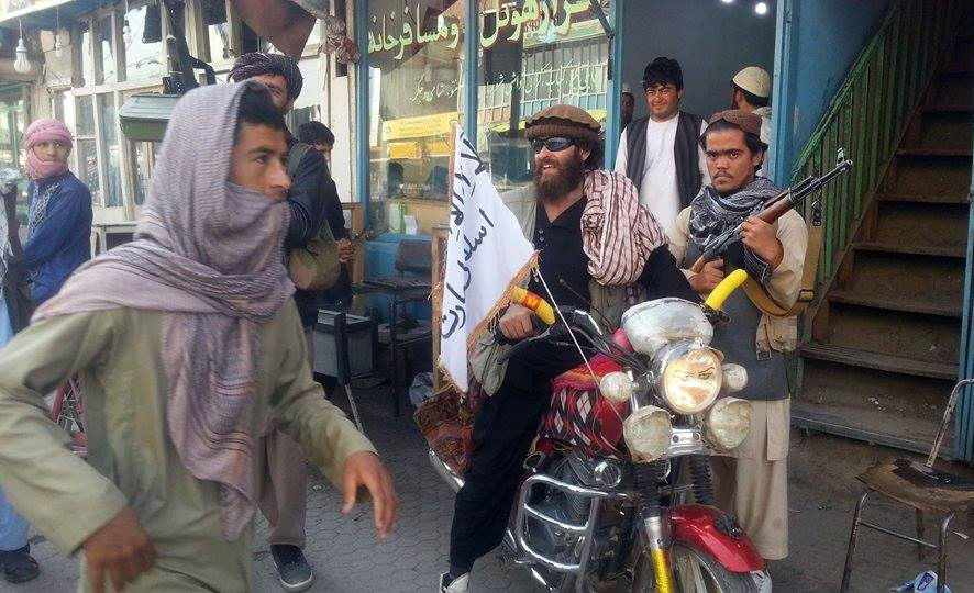 A Taliban fighter sits on his motorcycle adorned with a Taliban flag in Kunduz city, north of Kabul, Afghanistan, on Tuesday. The Associated Press