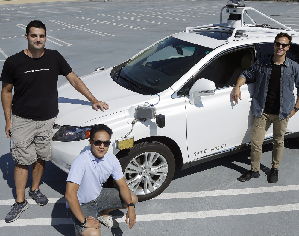 Brian Torcellini, Google team leader of driving operations, right, is seen with safety specialists Rob Miller, left, and Ryan Espinosa at Mountain View, Calif.