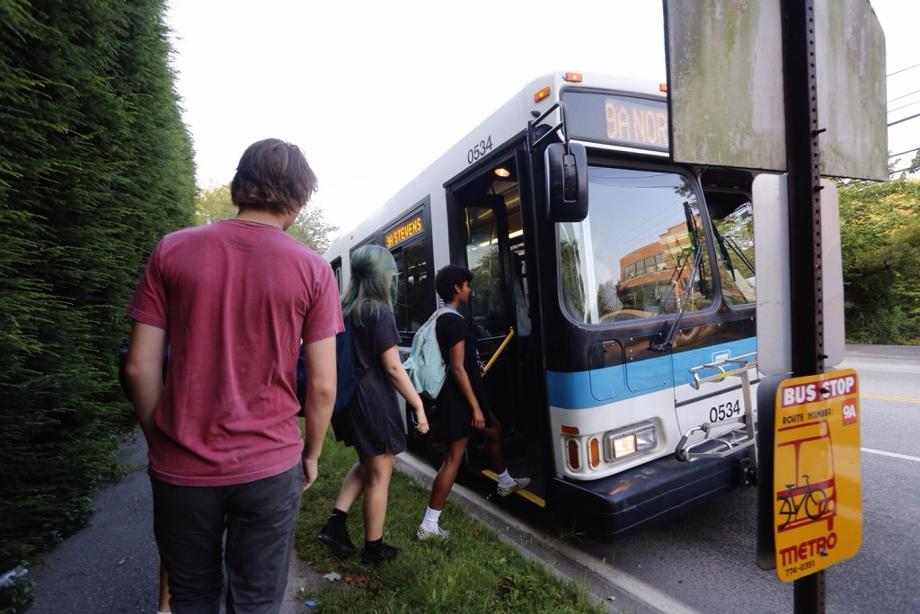 Casco Bay High School students get on a metro bus on Stevens Avenue as they head to school on the first day Wednesday. Derek Davis/Staff Photographer