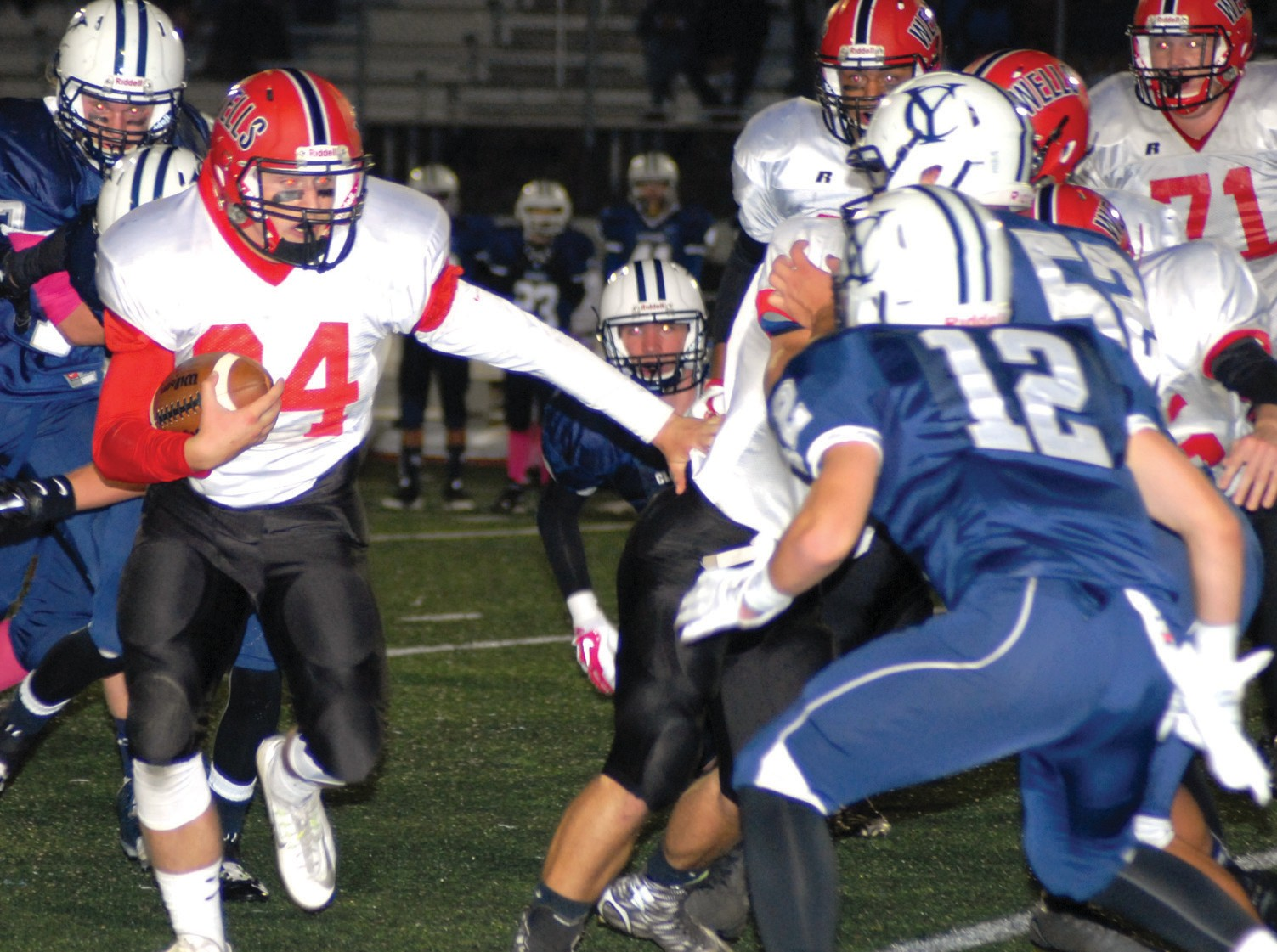 Wells running back Jake Spofford picks up some yards during Friday night's game at Yarmouth.