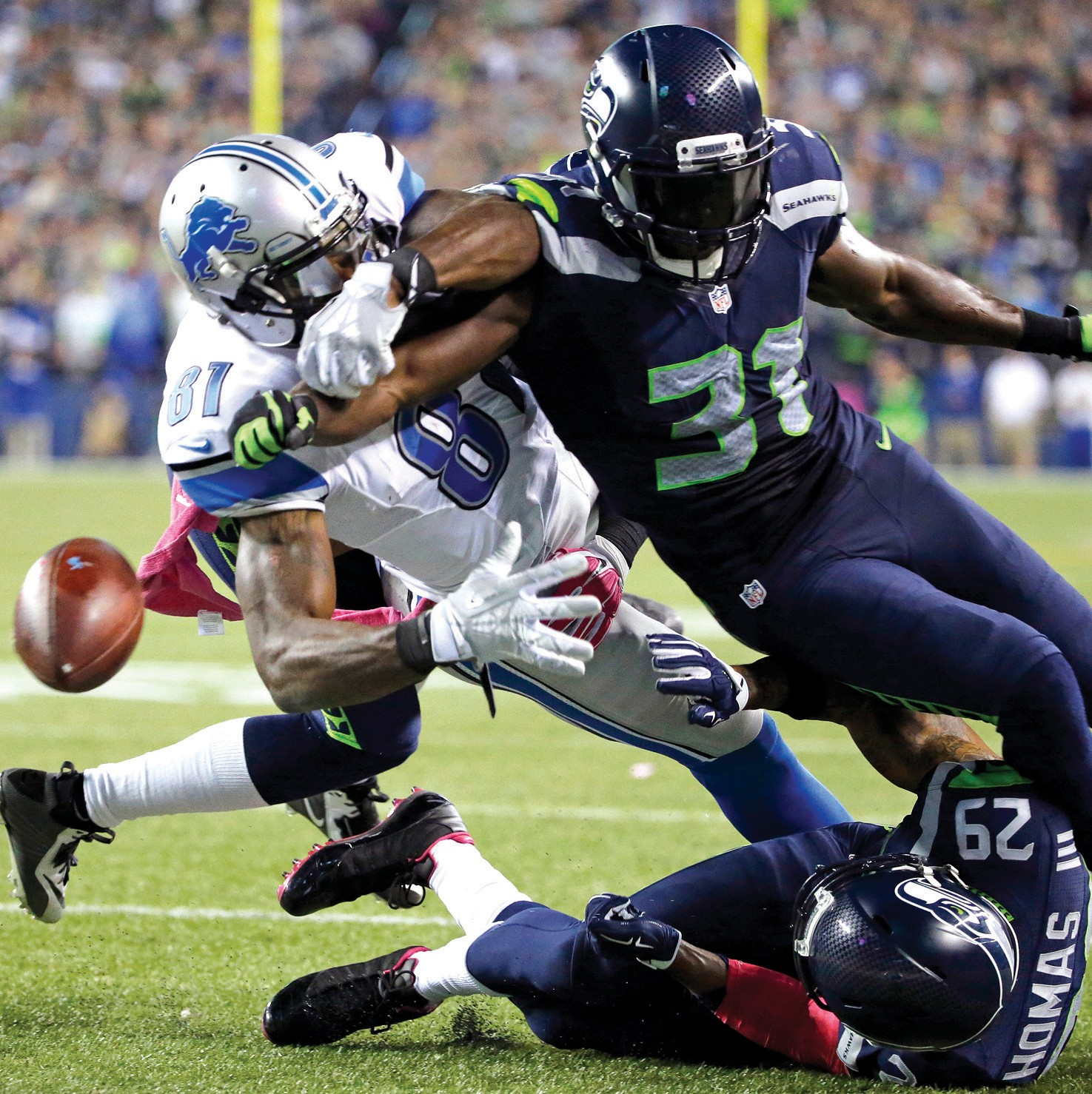 Seattle Seahawks strong safety Kam Chancellor (31) knocks the ball loose from Detroit Lions wide receiver Calvin Johnson (81) in the second half on Monday in Seattle. The fumble went out of bounds in the end zone and was ruled a touchback. The Seahawks beat the Lions 13-10.