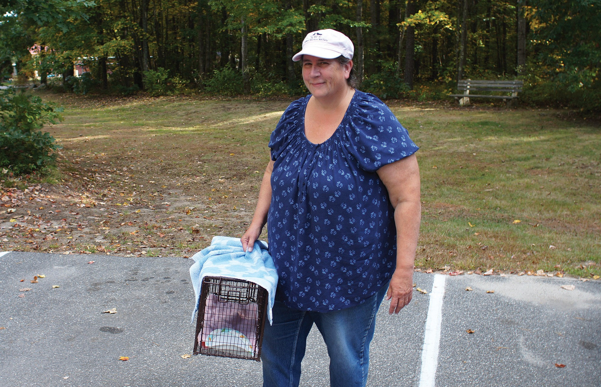 Kathy Deschambault is pictured with her cat-trapping equipment at the West Kennebunk Animal Welfare Society on Wednesday.