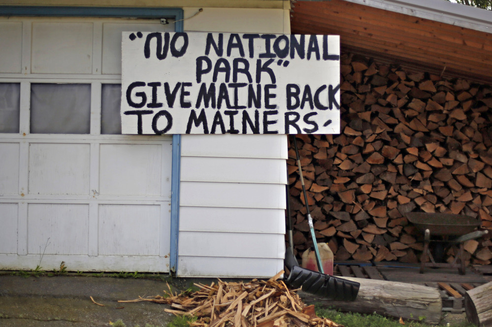 A sign in opposition to a proposed national park is posted on a home in Millinocket.