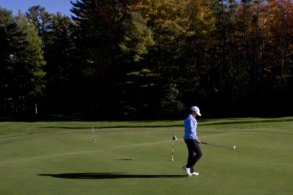 """Hashilla Rivai of Thornton Academy not only is widely expected to repeat as the girls' state golf champion, but may give the boys' players a run for the top overall score. """"I don't know. I feel like we're on the same level,"""" she says."""