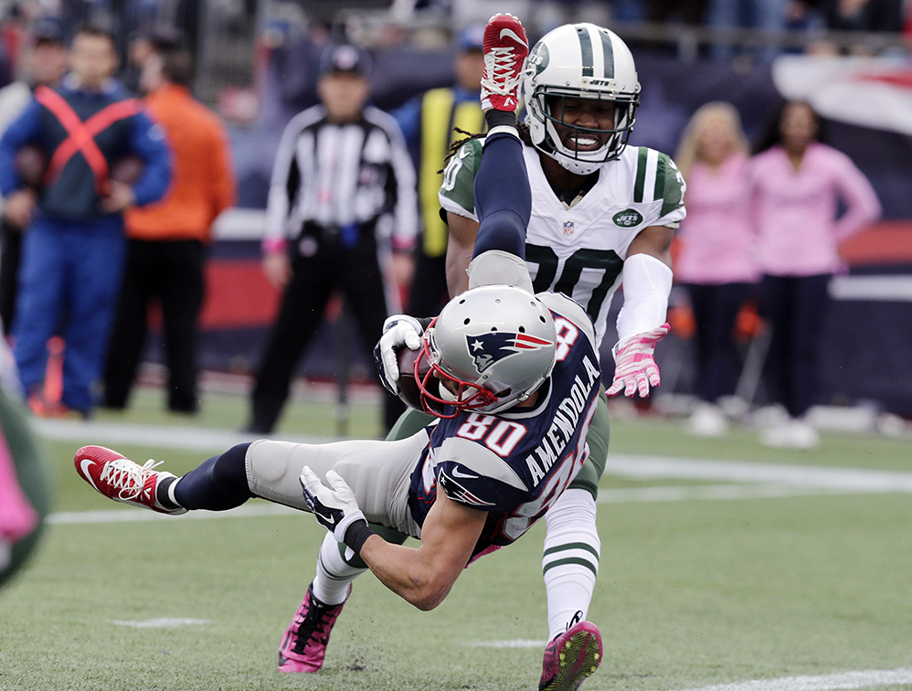 New England Patriots wide receiver Danny Amendola (80) scores a touchdown after catching a pass in front of New York Jets cornerback Marcus Williams (20) in the second half Sunday in Foxborough, Mass. The Associated Press