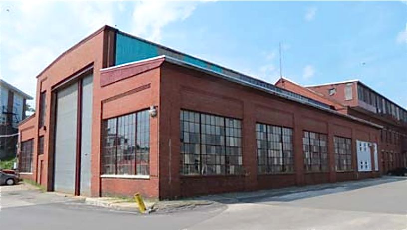 "Building 1, known as the  at the Erecting Shop, was built in 1918 to replace an earlier wooden building, according to a 2014 consultant's report. Photo from Sutherland Conservation and Consulting's report titled ""The Portland Co. Historic Significance and Integrity."""