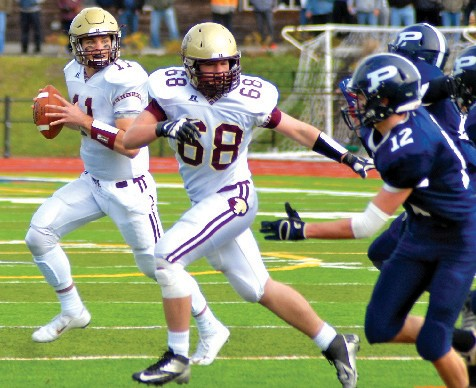 Thornton Academy quarterback Austin McCrum rolls out on a pass during last weekend's state championship game against Portland. McCrum has been selected as the Journal Tribune's co-Most Valuable Player along with his teammate Greg Ruff.