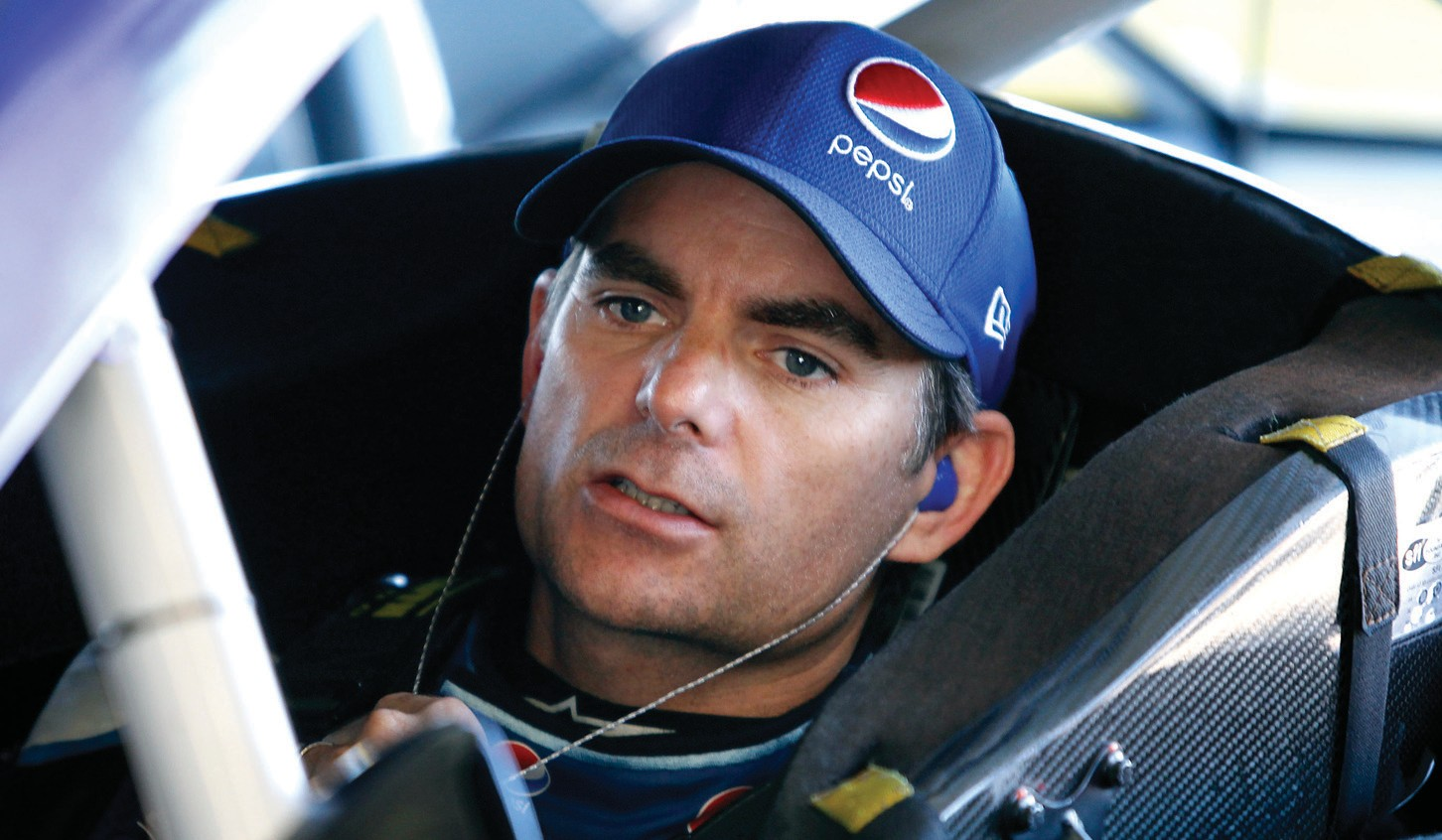 Series points leader Jeff Gordon sits in his car before a practice session for Sunday's NASCAR Sprint Cup Series auto race at Phoenix International Raceway, in Avondale, Ariz.