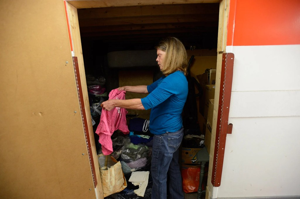Jane Footer goes through her possessions in search of clean clothes to wear.