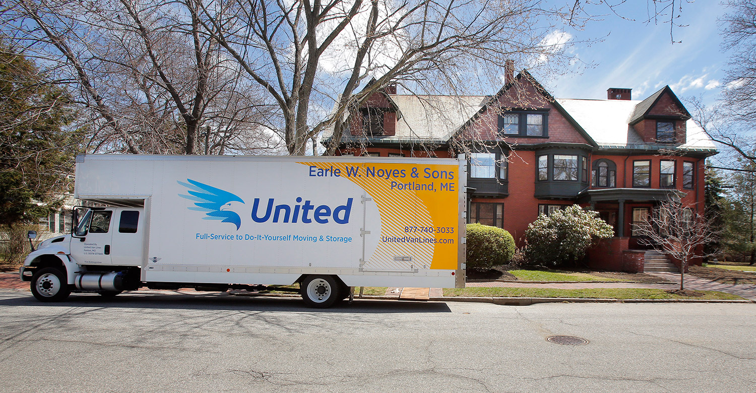 A moving van sits outside a West End home on Vaughn Street in Portland where Ivy McGrew found an apartment